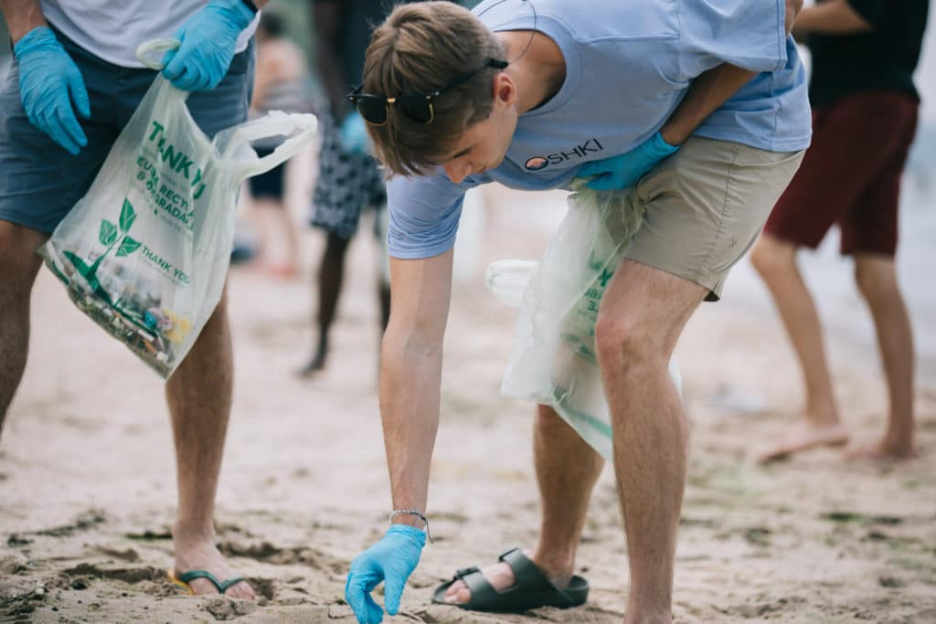 OSHKI, Great Lakes beach cleanup, Jackson Riegler, Lake Michigan plastics pollution, Great Lakes preservation, recycled clothing, upcycled plastics clothing, sustainable manufacturing, Optimize, University of Michigan